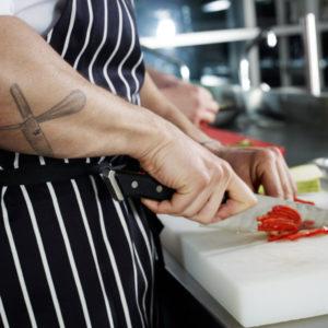 Photo of chef's hands cutting up food