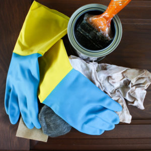 Photo of can of stain and rags for doing staining work