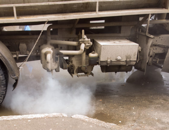 Photo of truck engine spewing diesel exhaust