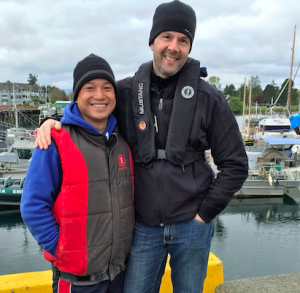 Safety advisor Trung Nguyen (left) wearing  a Mustang vest style PFD, with Ryan Ford.