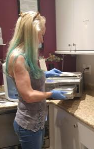 Julie Green, Manager/Piercer, working in the clean room at Westcoast Piercing and Ink