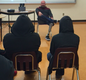 Micheal Lovett shares his story with students at Nlakapmux Independent School in Lytton, BC