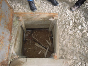 Below-ground valve box at a dairy farm. Image from WorkSafeBC