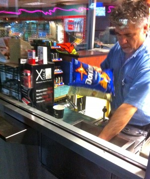 Photo of worker in convenience store