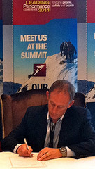 Paul Henning, vice president of Rio Tinto Alcan BC, signs the Health and Safety Leadership Charter