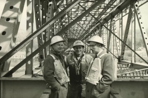 Photo of three workmen at the Second Narrows Bridge in 1958