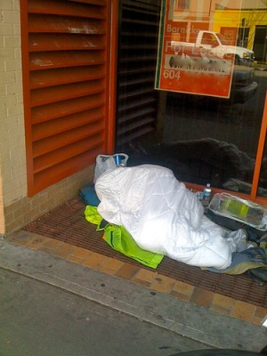 Sleeping outside on Commercial Drive in Vancouver BC, Nov. 2010. S. Main phot