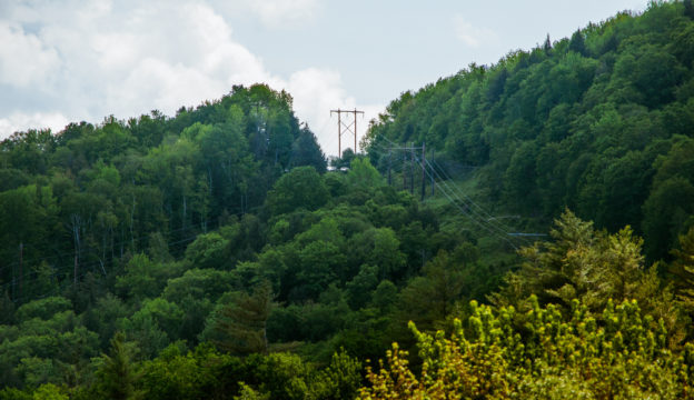 Photo of transmission line over a mountain
