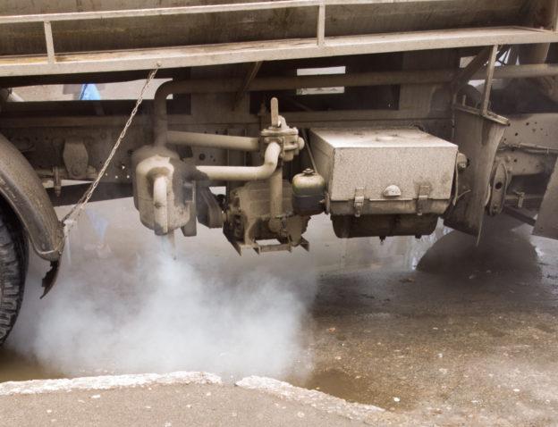 Photo of truck engine spewing diesel exhaust