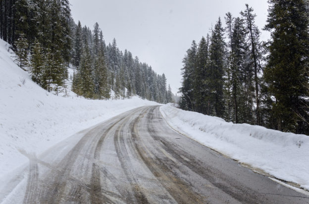 Photo of mountain road with snow and ice