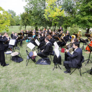Photo of a symphony orchestra in a park