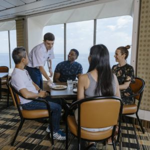 Photo of server, with passengers seated at a table, at the Pacific Buffet on a BC Ferries vesssel