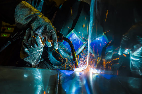 Photo of welding metal in factory