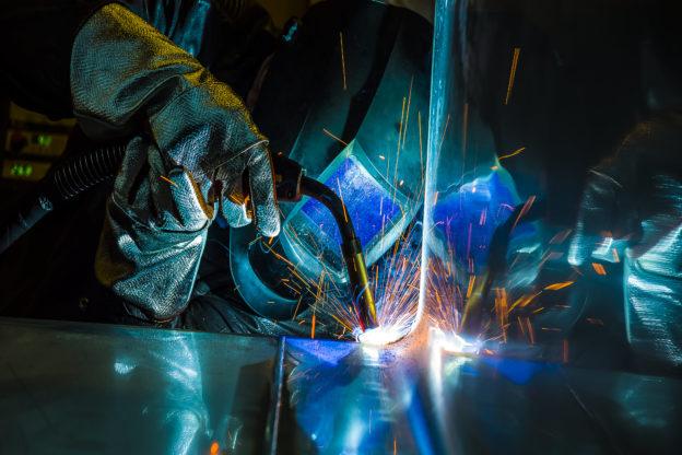 Photo of welding metal in factory