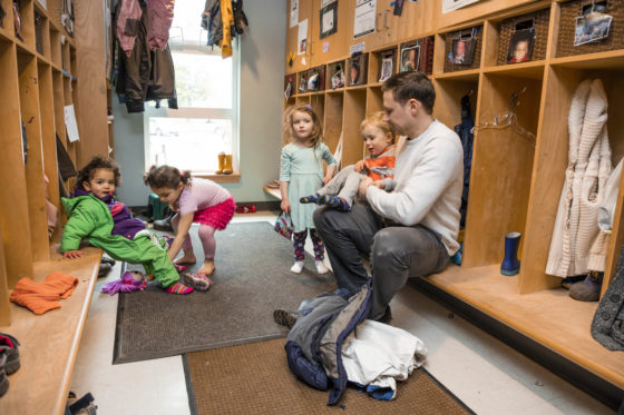 Photo of children and in cloakroom of a child care facility