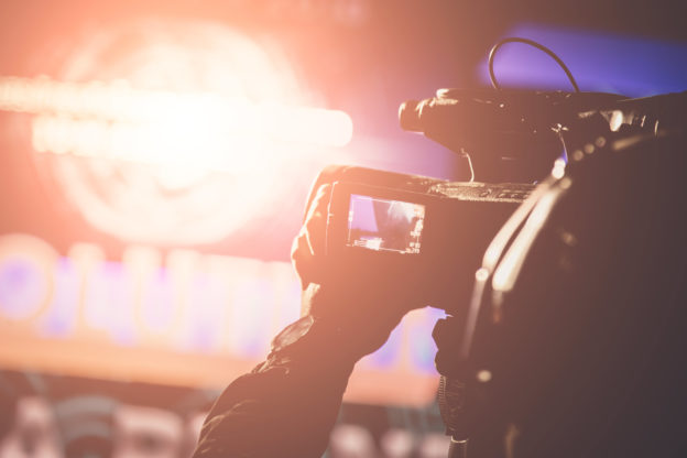 Photo of bright lights as operator works with video camera at an awards ceremony
