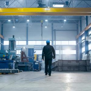 Photo of worker walking inside factory