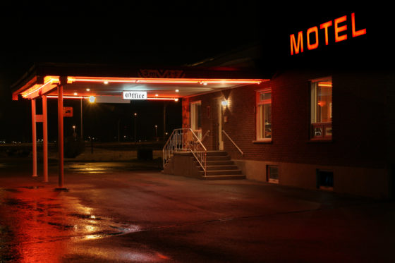 Photo of the outside of a motel office at night