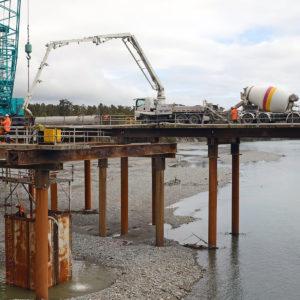 Photo of concrete pumper truck on bridge under construction