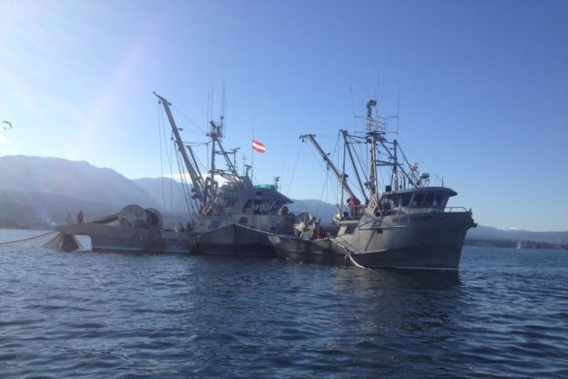 Photo of two fishing vessels on the water
