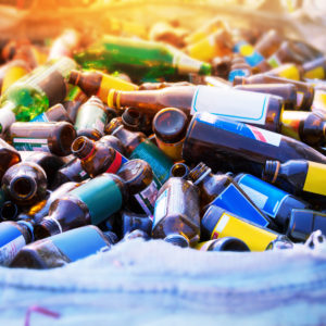 Photo of colourful empty, labelled bottles in a recycling bin