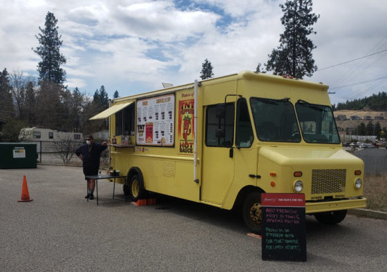 Photo of a bright yellow food truck supporting truck drivers