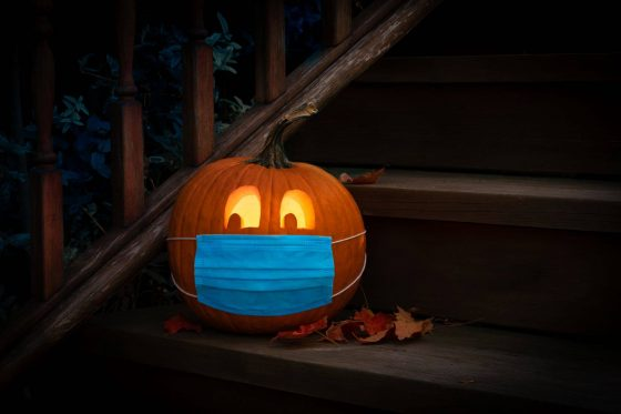 Photo of Halloween jack'o lantern with medical face mask