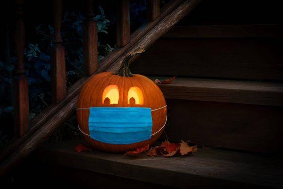 Photo of Halloween jack'o lantern with medical face mask