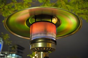 Photo of close-up of patio heater being used to keep people warm outdoors