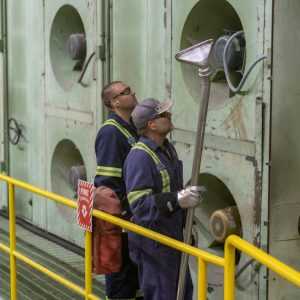 Photo of two workers at the pulp dryer area of the Domtar Kamloops Mill.