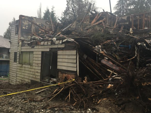 Photo of burned house with top story all caved in