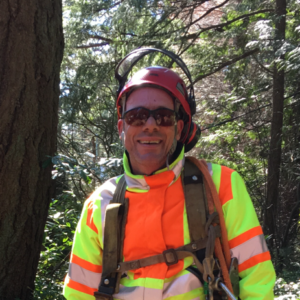 Photo of Shawn Michaels in the forest wearing safety gear.