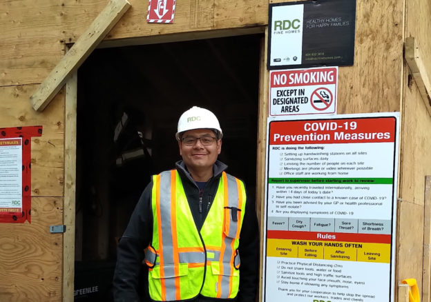 Photo of COVID-19 compliance officer at worksite